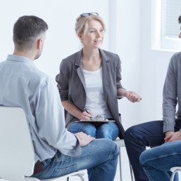 A 3-person team sitting in circle - Clarity Divorce
