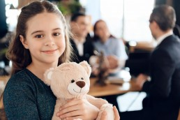 child holding teddy bear - Clarity Divorce